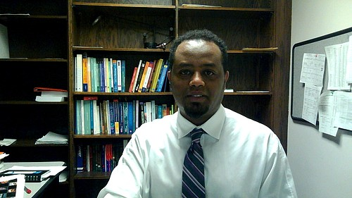 Dr. Menelik Geremew
